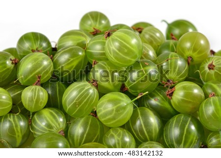 Heap of fresh green gooseberry close up on a white background