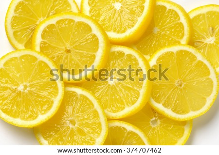 heap of fresh lemon slices on white - stock photo