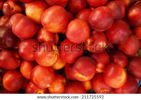 Heap of fresh organic peaches at a market/Peaches/Very shallow depth of field