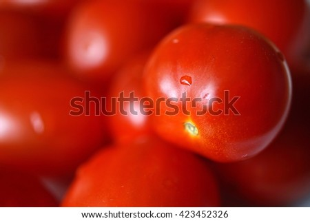 Heap of fresh red tomatoes with droplets of water as a symbol of vegetable freshness - stock photo