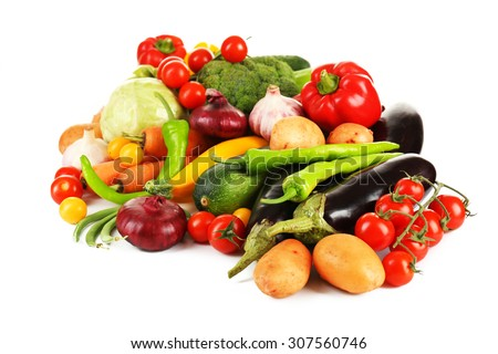 Heap of fresh vegetables isolated on white - stock photo