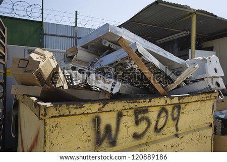 Heap of garbage in waste container - stock photo