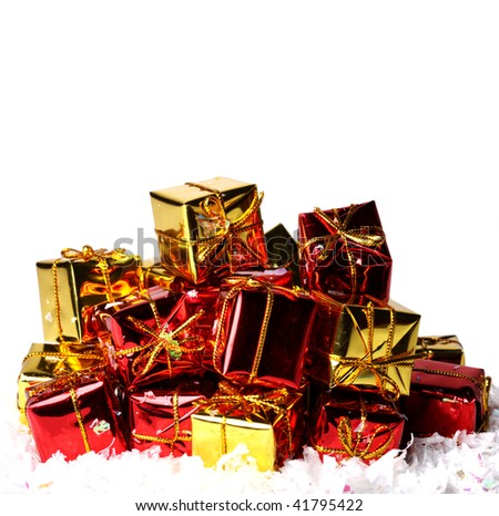 Heap of gifts on artificial snow isolated on white - stock photo