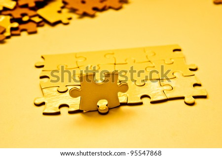 heap of golden puzzle pieces - stock photo
