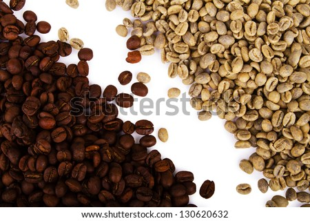 Heap of green and black coffee beans - stock photo