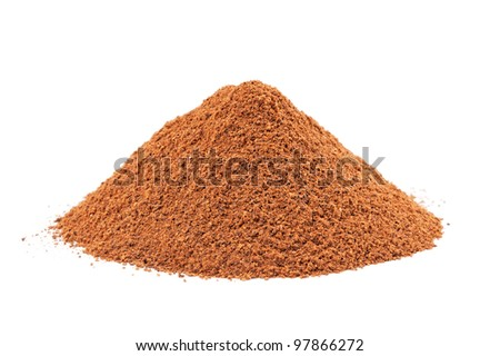 Heap of ground Cinnamon isolated on white background.  As a spice or condiment cinnamon sold in the form of sticks or a hammer. Used as a spice in cuisines all over the world. - stock photo