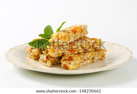 Heap of healthy munchies on plate - stock photo