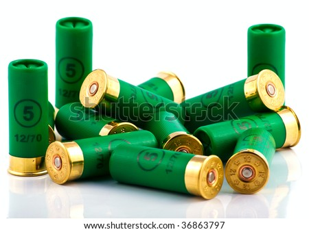 Heap of hunting cartridges for shotgun - stock photo