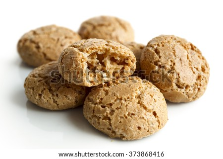 Heap of  Italian amaretti biscuits isolated on white in perspective. One broken in half. - stock photo