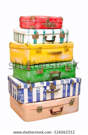 Heap of many-colored suitcases is on white background. - stock photo