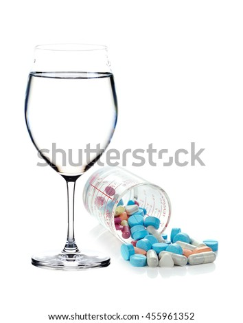Heap of medicine pills and water isolated on background. - stock photo