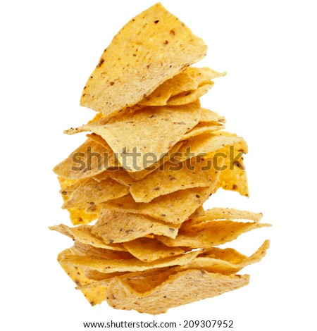 heap of Mexican nachos chips isolated on white background - stock photo