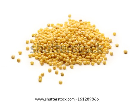 Heap of millet groats on white - stock photo