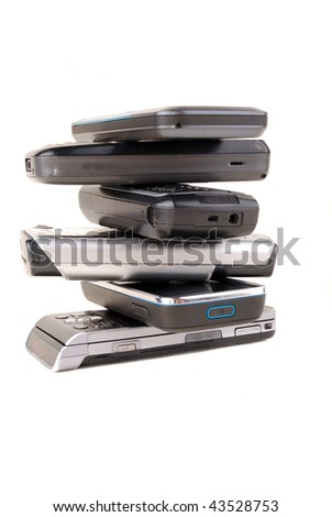 Heap of mobile phones isolated on white background