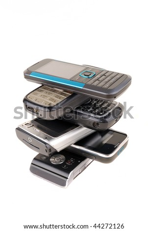 Heap of mobile phones isolated on white background - stock photo