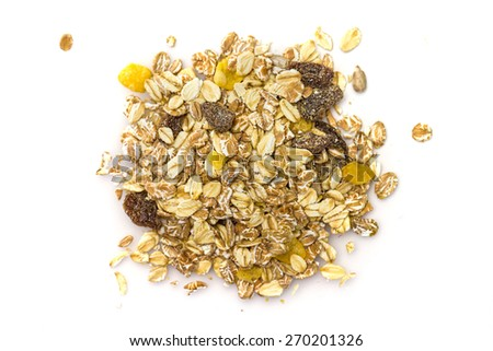 Heap of muesli isolated on white. Delicious granola cereal mix, with dried fruit and seeds. - stock photo