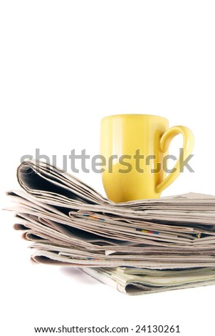 Heap of newspapers with yellow cap on the