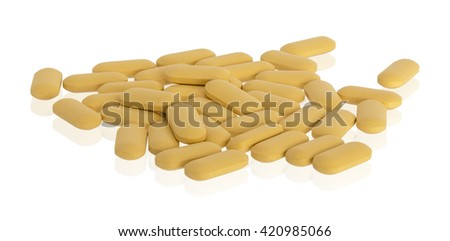 Heap of nutritional supplement multivitamin pills isolated on white background with clipping path - stock photo