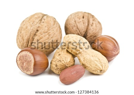 heap of nuts on white - stock photo