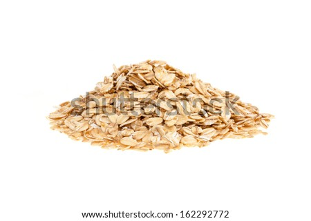 Heap of oat flakes - isolated on a white background - stock photo