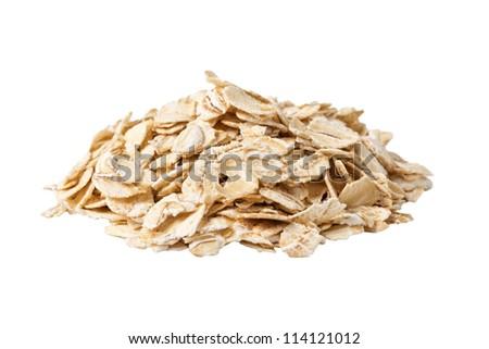 heap of oat flakes isolated on white background angle shot - stock photo
