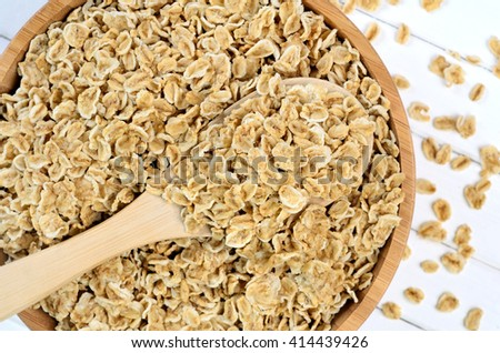 Heap of oats on bamboo bowl - stock photo