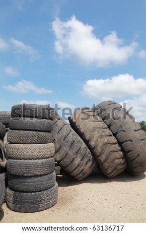 Heap of old truck tires prepared for recycling