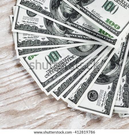 Heap of one hundred dollar bills. Fake money. Business concept. - stock photo