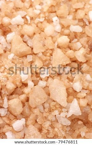Heap of peach-colored bath salt as background. - stock photo