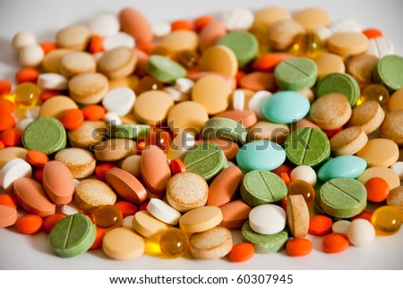 heap of pills isolated as a background - stock photo