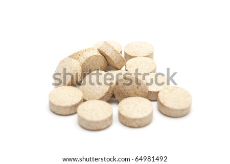heap of pills isolated on white - stock photo