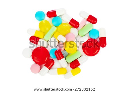 Heap of pills isolated on white background