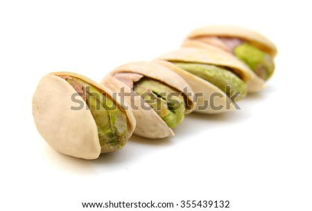 Heap of pistachios nuts isolated om the white - stock photo