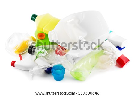 Heap of plastic garbage on white - stock photo