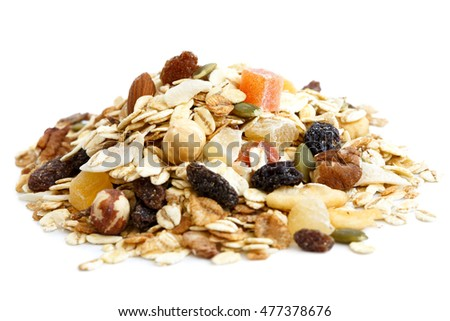 Heap of premium fruit and nut muesli isolated on white.