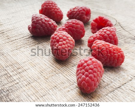 Heap of raspberry on a wooden background - stock photo