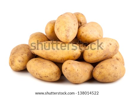 Heap of raw potatoes isolated on white background - stock photo