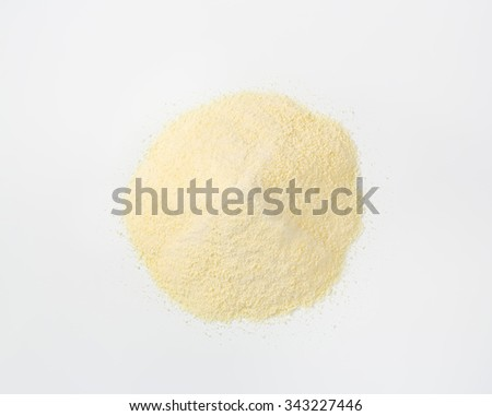Heap of raw semolina on white background - stock photo