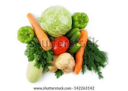 Heap of Raw Vegetables with Cabbage, Squash, Potatoes, Carrot, Green Bell Peppers, Tomato, Cucumbers, Parsley and Dill isolated on white background. Top View - stock photo