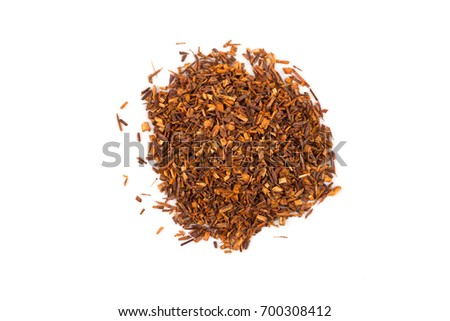 Heap of red dry rooibos healthy traditional organic tea on white isolated background
