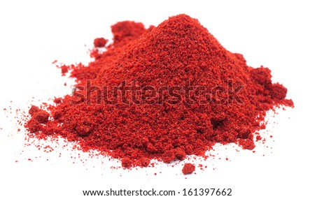 Heap of red pepper powder isolated on white background - stock photo