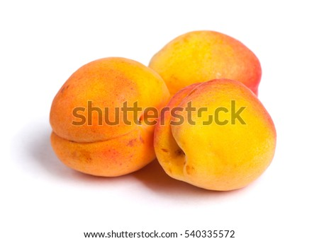 Heap of ripe apricots isolated on white background
