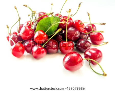 heap of ripe tasty cherries isolated on white background - stock photo