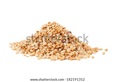 Heap of roasted crushed peanuts on white background - stock photo