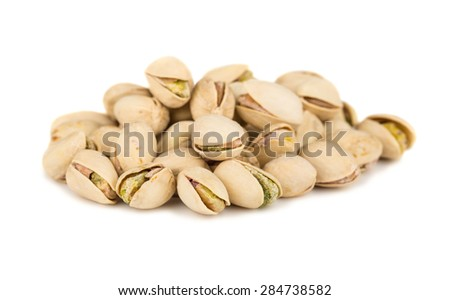 Heap of salted pistachio isolated on white background