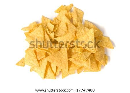 heap of salty yellow nachos on white ground - stock photo