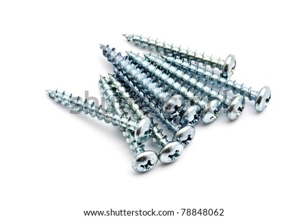 Heap of screws closeup on white background