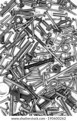 heap of screws on white - stock photo