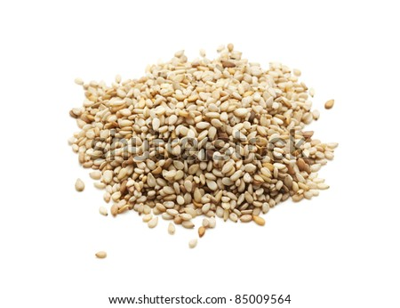 heap of sesame seeds isolated on white - stock photo