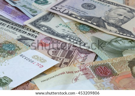 heap of several currencies banknotes